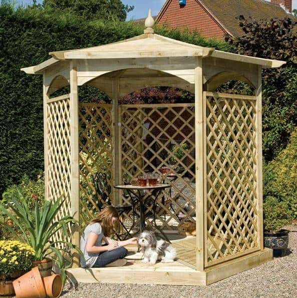 Hexagonal Wooden Pavilion with Floor, Side Trellis and Balustrade. Dimensions: 240 cm x 208 cm x Height 300 cm